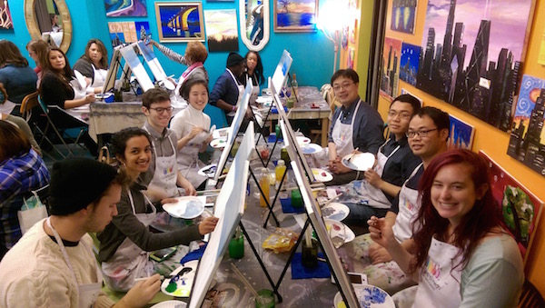 Bozhi Tian painting with his lab